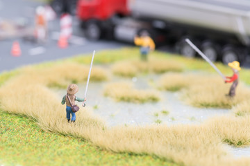 Miniature anglers near road close up