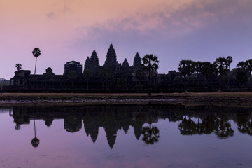 Sunrise in ancient Angkor Wat temple, Siem Reap, Cambodia. Reflection in lake