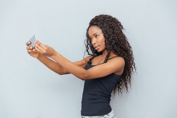 Afro american woman making selfie photo