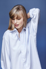 Blue shirt blond babe in blue studio