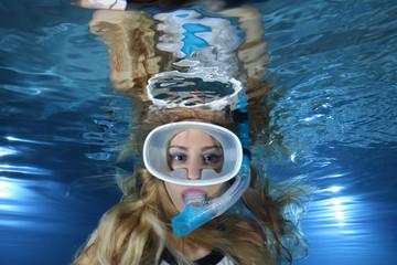 Portrait of female snorkeler underwater