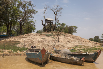 Tree house of the Tonle sap lakeshore. Cambodia. Wood boats in the close up