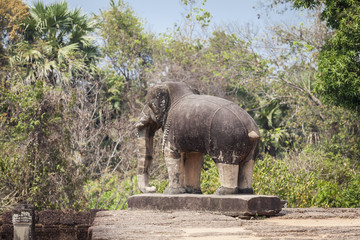 Elephant statue in East Mebon temple, Siem Reap, Cambodia. reen trees background