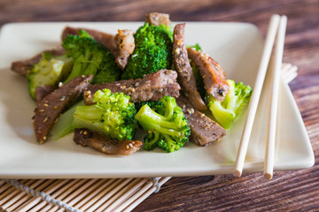 Asian cuisine, grilled meat with broccoli and sesame