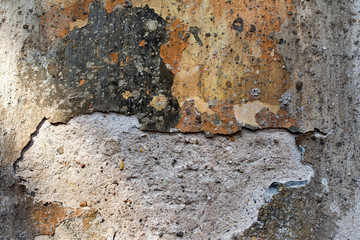 old wall with damaged polychromatic plaster - background