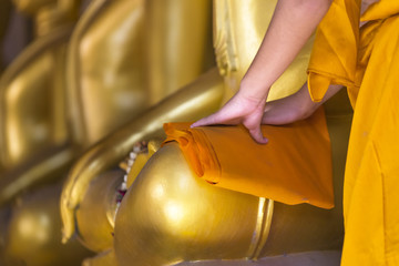 Cleaning Image of Buddha by Novice at Ayutthaya Historical Park