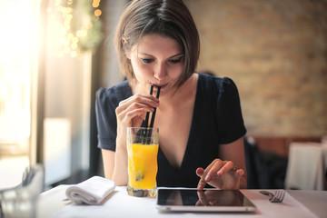Girl drinking orange juice