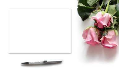 Mockup for presentations with roses, pen and paper