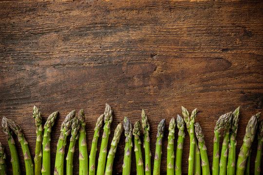 Fresh asparagus on wooden background