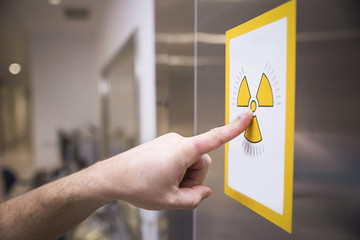 Radiation sign on door of operating room in a hospital