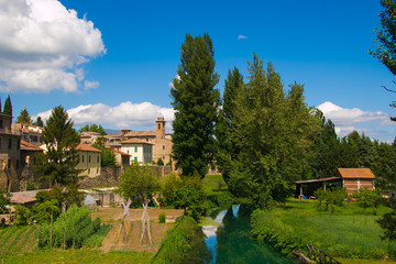 Bevagna seen from the bridge over Clitunno river; city walls and vegetable gardens