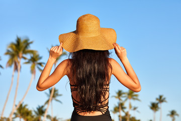 Woman in sunhat on a beach