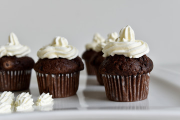 fresh homemade chocolate muffin with cream 