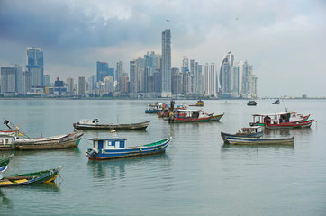 Fishing boats anchored with skyscrapers of Panama City in background, Pacific coast, Central America