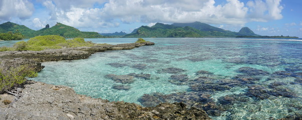 Panorama of Huahine island with shallow water of its lagoon, seen from an islet, near Maroe bay, Pacific ocean, French Polynesia