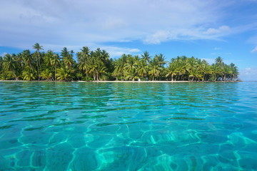 Turquoise water with tropical islet, Huahine island, Pacific ocean, French Polynesia