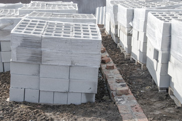 piles of cinder blocks neatly folded at the building
