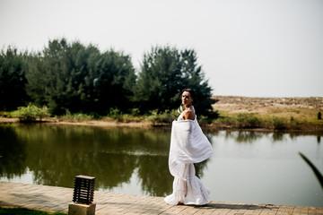 portrait of beautiful girl in white clothes dancing a beautiful dance mandala