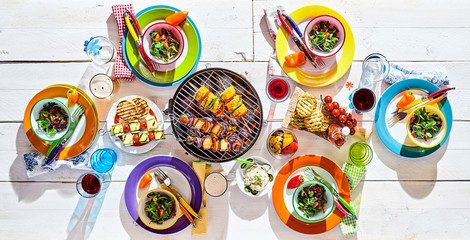 Poster Grill / Barbecue Colorful picnic table with vegan cuisine