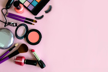 make up with cosmetics and brushes isolated on pink background