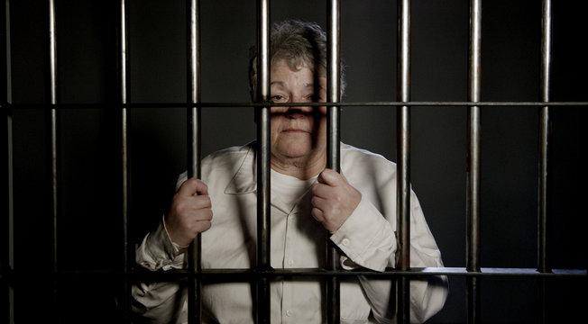 Elderly woman behind bars in jail