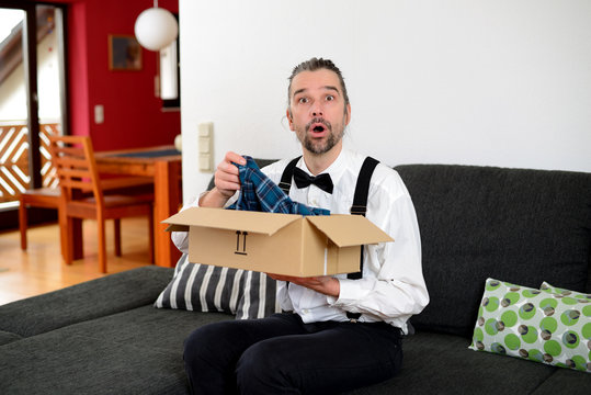 angry man opening the wrong package