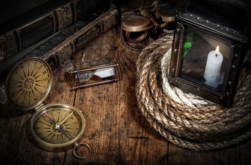Wall Mural - Scientific expedition and history background. Old book, compass, rope and vintage lamp on wood desk.