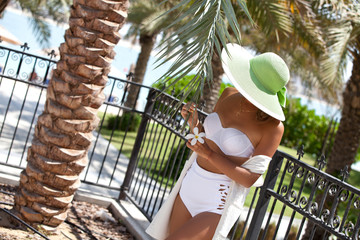 Tourist woman enjoying beautiful vacation time.