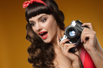 pin-up girl with retro camera