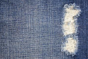 Blue torn denim jeans texture, Jeans background.