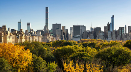 Fall in Central Park with Midtown skyscapers and high-rise buildings of the Upper East Side. New York City