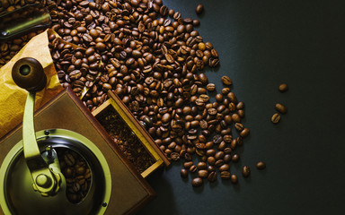 Coffee grinder and coffee beans.