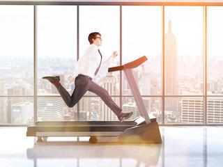 Businessman on treadmill toning
