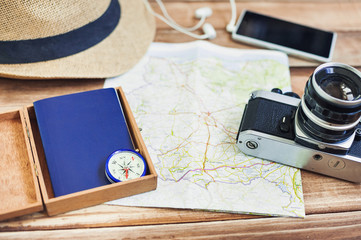 Accessories for travel. Passport, photo camera, smart phone and travel map. Holidays and tourism concept