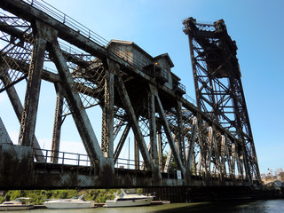 Rusty old industrial railroad lift bridge over Chicago canal - landscape color photo