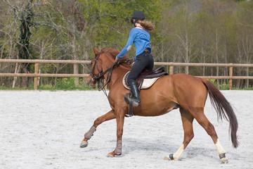 pretty woman riding horse