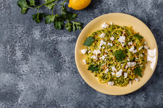 Homemade Zucchini  Zoodles Pasta with Pine nuts and Feta.
