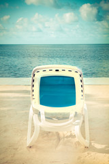 Wall Mural - Cool tone beach lounge chair with sand and ocean