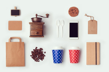 Coffee shop mock up template with paper bag and cups. View from above. Flat lay