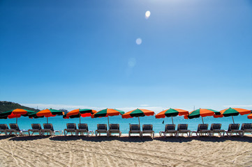 Beach chairs standing in line