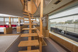 Wooden staircase in salon of luxury yacht