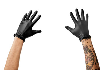 Man's hands with tattoo in black latex gloves