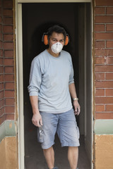 Home renovator emerges from the dust after cutting into a wall