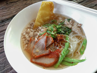 Thai style tom yum noodle on wooden table