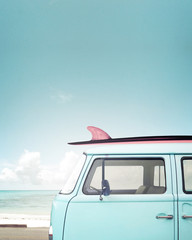 Fototapete - Vintage car parked on the tropical beach (seaside) with a surfboard on the roof