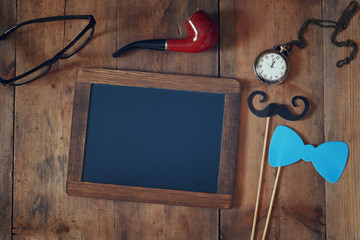 blank blackboard and composition of man's accessories