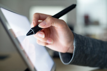 Woman draft on tablet