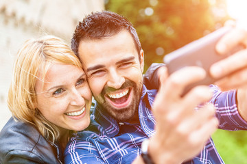 Mid Adults Couple Taking Pictures with a Smartphone