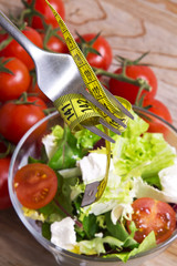 salad and fork with tape measure