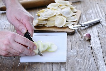 Close-up of person cutting onion